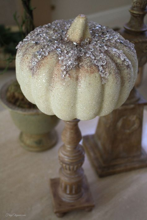 FrugElegance Home Decor Fall Pumpkins~love perching a pumpkin on a candlestick. Add some fall on your year round decor items.