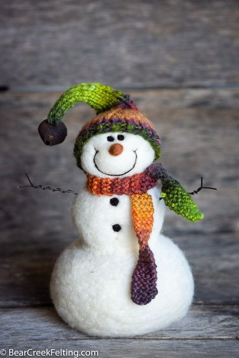 Needle Felt Snowman by fiber artist Teresa Perleberg of Bear Creek Felting. Solid wool snowmen with hand painted, hand-spun, hand-knit hats and scarves and of course they are 100% wool too. Needle felted with the wool from the artists flock of sheep. #snowmen