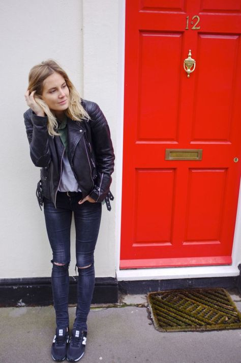 Street Style: Extra-fitted denim, New Balance sneakers Biker black leather jacket