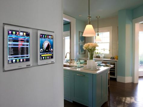 Docking Station  -  A whole-home automation system brings the home's technology — door locks, lighting, security cameras, shade control, pool control and the entertainment system — together. A magnetic mount houses two smart tablets that can be removed and used throughout the home. Two accompanying tabletop mounts, located in the master bedroom and loft areas, feature the same functionality.