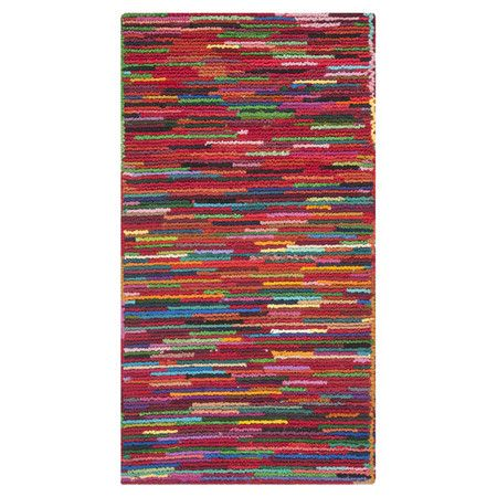 Anchor your living room or define a space in your master suite with this hand-tufted cotton rug, showcasing a multicolor stripe motif.