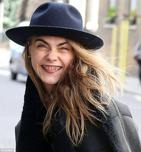 Cara Delevingne wears gold grill to meet Michelle Rodriguez Cara stuck her tongue out at photographers, showing off her metal mouthpiece by designer Dolly Cohen which are personalised with her name.ing to London's Notting Hill.