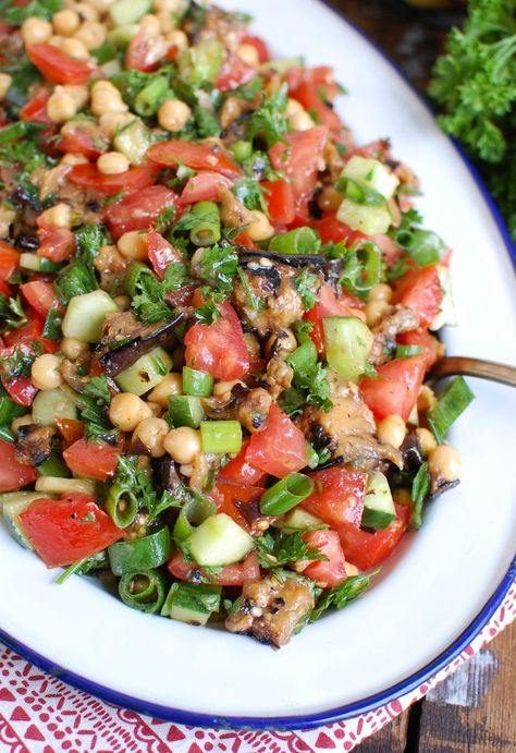 Mediterranean Eggplant Chickpea Salad is full of fresh end of summer vegetables and topped with a light, lemony dressing. This salad makes a greataddition to a BBQ, a side dish to yourMediterranean meals or an easy on-the-go lunch.// acedarspoon.com #eggplant #grilledeggplant #salad #vegetarian #vegan #mediterraneandiet #lunch #easysalad #healthysalad #veganrecipe #chickpeasalad