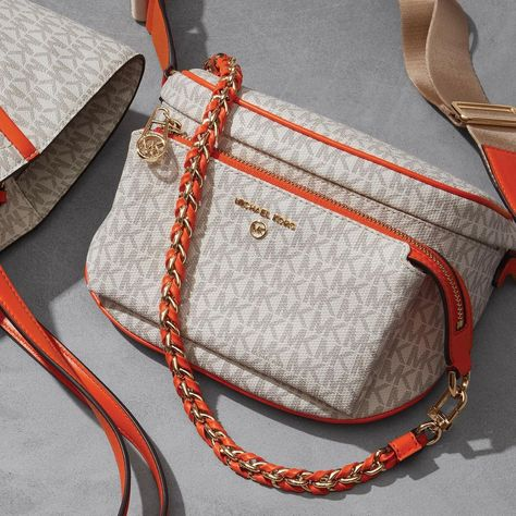 """Michael Kors: """"Logo with a twist 🍊: a bright orange trim gives our Slater sling pack a luxe new look. #MichaelKors"""""""
