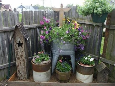 Love this idea for a section with a similar layout in our backyard…….I'm thinking red geraniums would really pop against the aged metals!