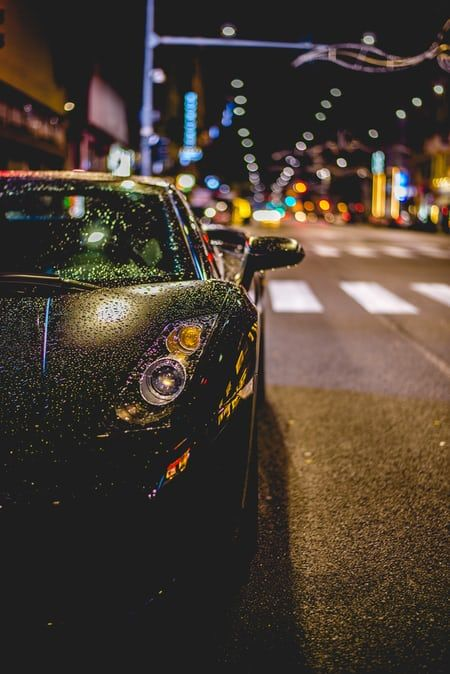Gray And Black Road Bike Parked Beside Wall Overseeing On Glass Window Photo Free Sunset Image On Unsplash Car Wallpapers Hd Wallpapers Of Cars Car Pictures
