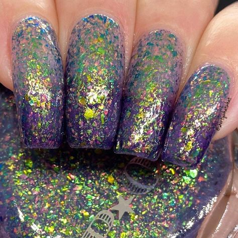 Here we have the It's Witchcraft Collection. This is Caster Castor she is a try thermal purple in cooler temperatures ,a beautiful blue, in warmer temperatures it lightens to grayish pink in hot temperatures. Each one of the polishes from this collection have shifting flakes in autumnal colors. This one has green and red multi chrome flakes, each shifting three different colors. For those new to thermals, the pigment in the polish reacts to temperature variations. Think mood ring, but with only