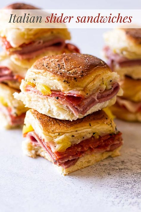 These Italian sandwich sliders have three kinds of salami with melted provolone . - These Italian sandwich sliders have three kinds of salami with melted provolone and a tangy kick fr - Gourmet Sandwiches, Mini Sandwiches, Sandwich Au Salami, Sandwich Bar, Sandwiches For Lunch, Mini Sandwich Appetizers, Simple Sandwich Recipes, Sandwich Melts, Italian Sandwiches