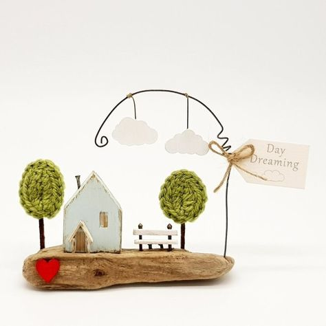 """New in the shop today is this little driftwood cottage scene tilted  """"Day Dreaming"""" ☁️ Do you have a favourite spot you like to sit and while away the hours? Mine is my garden bench with a coffe or an evening gin. #daydream #daydreamer #daydreaming #driftwood #driftwoodart #driftwoodhouse #driftwoodcottage #mixedmedia #mixedmediaart #coastal #coastalcottage #nautical #nauticaldecor #nauticalart #driftwoodscene #coastalart #seaside #seasidecottage #bspoque"""