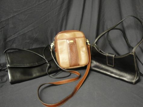 (3) Lovely Purses: Includes a Black Leather Fossil Purse. A faux brown leather America Purse with lots of compartments and shoulder strap. Plus a faux black leather purse with shoulder strap.