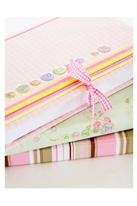 Patterned-Paper Book Covers - Use your leftover scrapbooking supplies to craft these pretty book covers. Wrap books with sheets of paper, wallpaper, or gift wrap, folding the paper about 3 inches to the inside of the cover at the front and back. Label your books with adhesive-backed letters. Embellish with ribbon trims and ties.