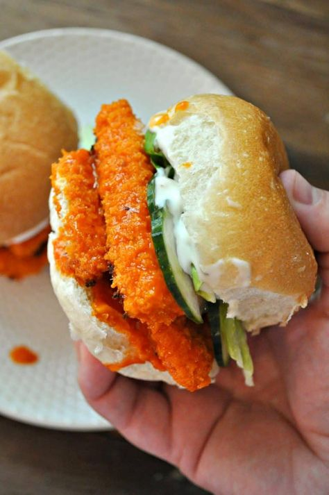 This vegan garlic buffalo tofu sandwich is to die for. Crispy baked tofu tossed in garlic buffalo sauce, topped with sweet pickles and vegan blue cheese. Vegan Dinner Recipes, Tofu Recipes, Whole Food Recipes, Vegetarian Recipes, Cooking Recipes, Vegan Vegetarian, Healthy Recipes, Healthy Food, Vegan Sandwich Recipes