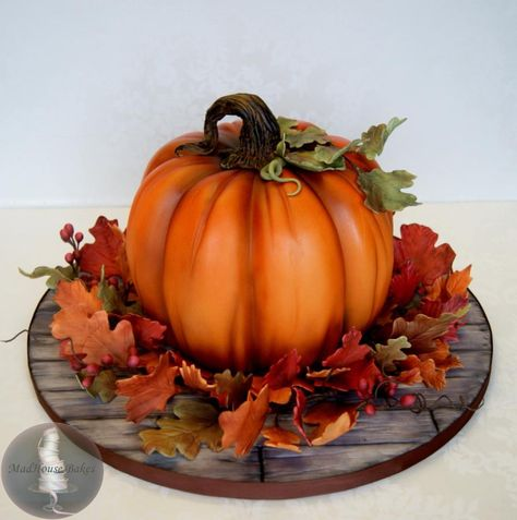 Pumpkin Cake for Fall – All leaves, berries, and the stem are gumpaste. The fond… Pumpkin Cake for Fall – All leaves, berries, and the stem are gumpaste. The fondant board is detailed to look like weathered wood (hand-painted). Bolo Halloween, Halloween Torte, Dessert Halloween, Halloween Fondant Cake, Pretty Cakes, Cute Cakes, Beautiful Cakes, Amazing Cakes, Fondant Cakes