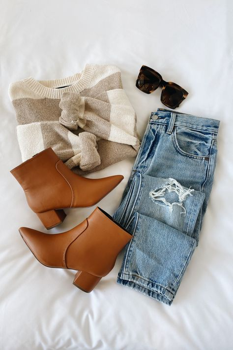 If the conversation isn't about cozy knits, the Lulus Talking About Comfort White and Taupe Striped Sweater isn't interested! This trendy knit sweater, with white and taupe stripes throughout, creates a round neckline, a wide bodice, and long balloon sleeves with drop shoulders. Style with brown boots and distressed denim for a casual fall outfit. #lovelulus