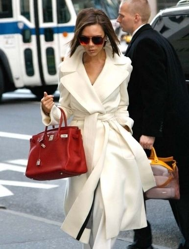 Red Birkin bag with off-white coat! Note: Birkin bags are only sold through Hermes stores, so if you are looking for one, you can only really trust that it's genuine by going directly to their stores.