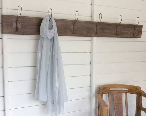 Vintage style coat rack.Vintage style coat racks are a stylish and practical way to store all your coats. Made wood with 6 vintage style metal double hooks, this simple, elegant design would fit well in a traditional setting or works well in more modern industrial rooms. The wood has a distressed finish which adds to the vintage character of the coat rack. These coat racks have two hooks on the back for affixing to the wall.Wooden rack. Metal hooks.Length 140cm Height 14cm