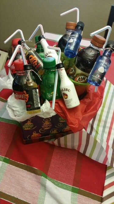 Mini alcohol bottles and mini soda bottles in a gift basket. Perfect as a gift to couples.