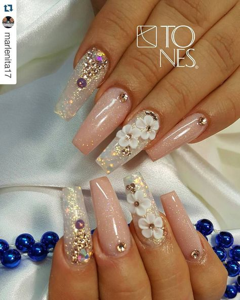 Nude nails with flower and rhinestone nail art