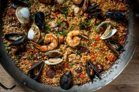 """Paella Valenciana."" Mussels, clams, shrimp, Spanish pork sausage, chicken & Calasparra rice."