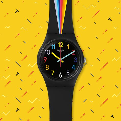 FOUNTAIN OF COLORS Swatch watch has a rainbow prism across its strap. Fantastical colors play on the dial as well, where every number is colored in a special shade of fun. This Swatch watch is perfect for a casual and colorful style.