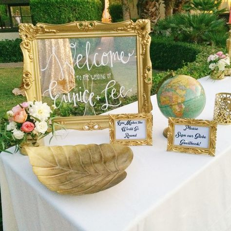 Welcome table with Globe sign-in book for guests! Perfect for the bride and groom who love to travel or travel themed weddings! Designed by Lovelyfest.