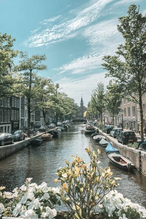 Planning a trip to Amsterdam? The canals are a defining feature of the city and a must-see. Check out my guide to the prettiest canals in Amsterdam on TVOB! #netherlands #travel #nature #adventure