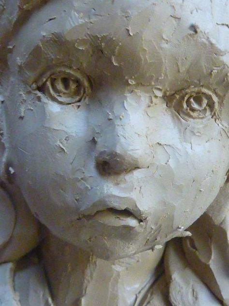 What haunting eyes the child in this sculpture has.