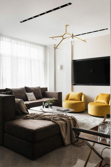 lampadari-moderni-soggiorno-divano-colore-scuro-tavolini-poltrone ...