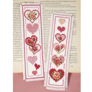 """Hearts and Flowers Bookmarks HEART TO HEART bookmarks for lovers of prose, poetry and romance! Counted cross stitch kit includes 14-count white Aida cloth, presorted DMC cotton floss, needle, chart and directions. Set of two, each 2 1/2"""" x 8"""". Imported from Belgium. A Stitchery exclusive! **** Hearts and Flowers Bookmarks Item #: T21670 Price: $19.99"""