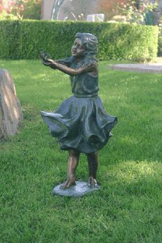 bronze garden statues. windy - girl holding bird bronze garden statue, small statues n