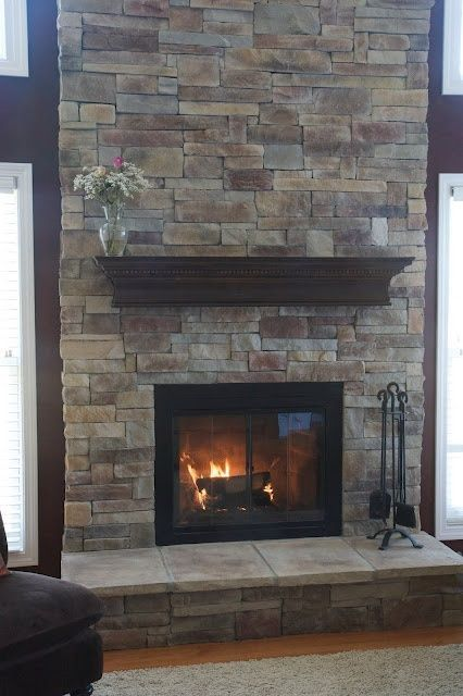 Refaced fireplace with manufactured stone veneer... LOVE this! I was just  thinking about doing this to the fire place in the dining room!