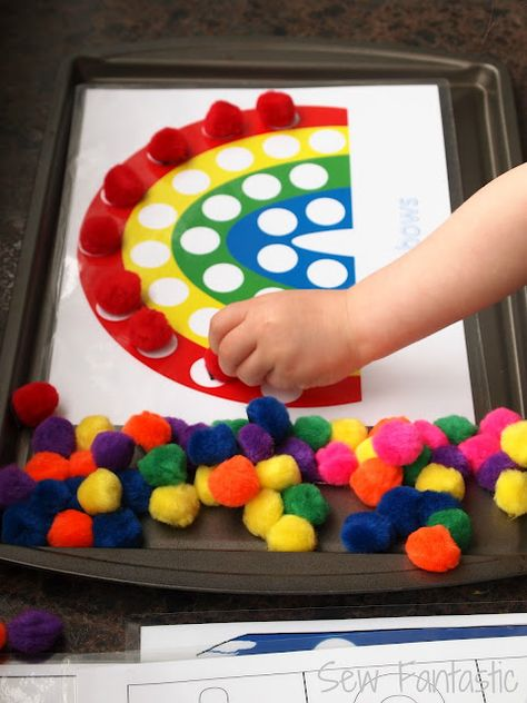 great color-sorting and counting!  pompoms, magnets, print-outs, and a cookie sheet. Such an easy idea!!