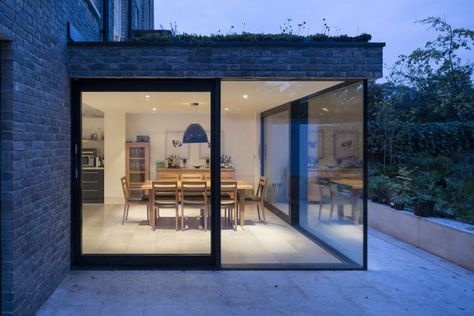 This arrangement with glazing and the path running around the front is close to what we're looking for - consider a short wall with planting (privacy) and cedar cladding