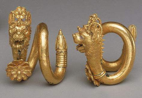 Gold and copper alloy spiral earring with lion-griffin head terminal | Greek, Cypriot | Classical | The Met