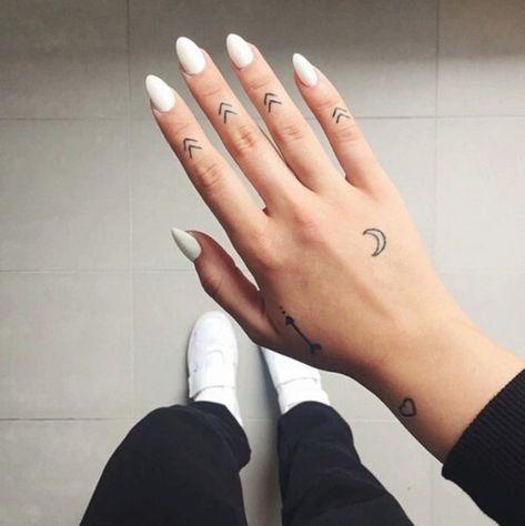 Symmetrical Symbols - Fresh And Creative Finger Tattoos - Photos