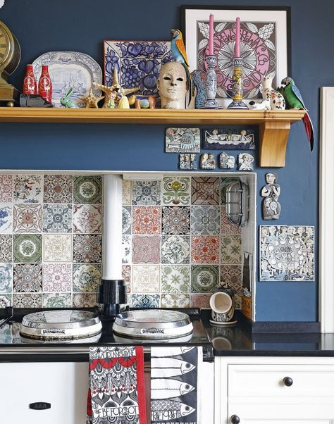 Blue Country Kitchen with White Range Cooker and Mix-and-match Patterned Splashback