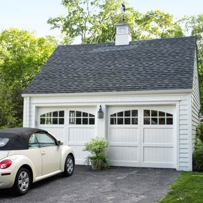 Custom Carriage House Doors A Cuppola And Lantern Style Light Fixture Transform This Garage From Ey Garage Door Design Carriage House Doors Garage Door Styles
