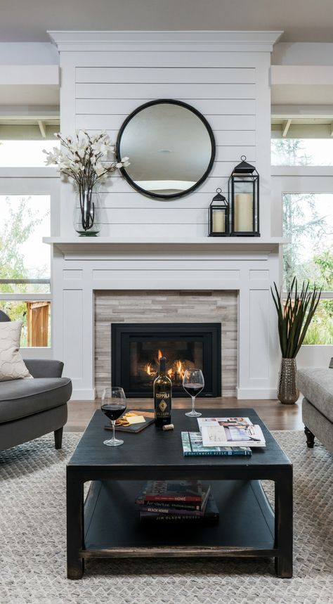This approachable room is made for relaxing. Traditional farmhouse elements blend with modern touches, centered on Heat & Glo's Escape Gas FireBrick Insert, featuring authentic masonry appearance and 25% more radiant heat.