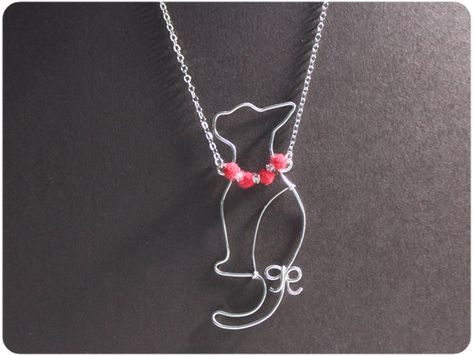 Cat w/ red necklace,