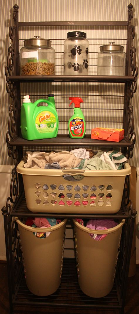 I am an organizer, always have been.  I've always hated laundry baskets, overflowing and ugly.  So, I bought a bakers rack and transformed it into laundry storage.  =)  Don't mind my dirty clothes!