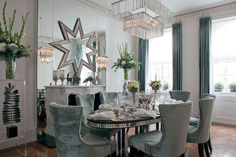 Holiday dining room decor theme - icy blue velvet studded chairs with a mirrored dining table.
