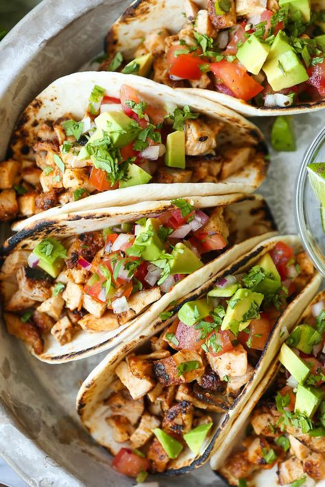 Easy Chicken Tacos - - Easy Chicken Tacos Dinner or Lunch Recipe ideas Easy Chicken Tacos – With a simple spice rub, the chicken is cooked so quickly on the stovetop! Dice into small pieces and serve with pico, avocado + lime! Chicken Taco Recipes, Mexican Food Recipes, Dinner Recipes, Healthy Chicken Tacos, Taco Chicken, Baked Chicken Tacos, Ground Chicken Tacos, Healthy Taco Recipes, Shredded Chicken Tacos