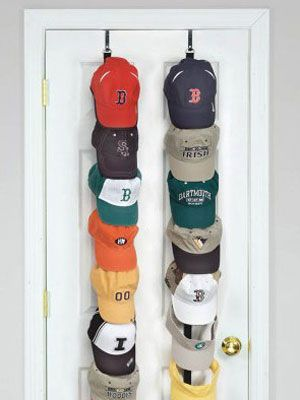 Display your team spirit while keeping your family's baseball hat collection in order with this handy holder that slings over the back of any door. Each rack holds up to 18 caps and keeps hats from getting crushed in drawers or cabinets.  - WomansDay.com