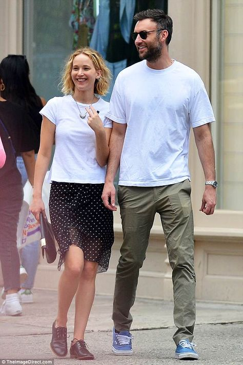 Cute couple: Jennifer Lawrence appeared to be happily over her ex boyfriend as she stepped out for a romantic evening with rumored new sweetheart Cooke Maroney in New York on Tuesday