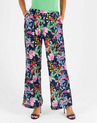 e3eeb0c4c932 Escorpion pantalón ancho estampado con fondo azul marino y flores  multicolor. Pantalón con cintura de goma y bolsillos | Escorpion ropa mujer  | Pantalones, ...