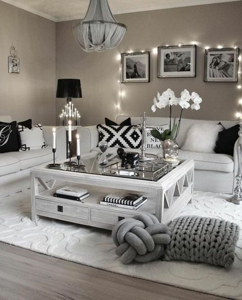 ▷ 1001 + Ideas for Living Room Color Ideas to Transform Your Home mink colored walls, two off white sofas with black and white cushions, white wooden table with glass top, wooden floor and white carpet, three framed images and fairy lights Silver Living Room, Living Room Grey, Home Living Room, Apartment Living, Black And White Living Room Decor, Cosy Apartment, Apartment Interior, Living Room Decor Cozy, Living Room Colors