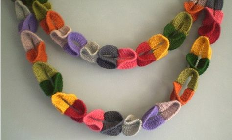 Ring Garland-This pattern is available as a free Ravelry download. This decoration is made up of simple garter stitch rings sewn together. The rings are fun to knit and are an ideal way to use up scraps of yarn. This would make a good group project.