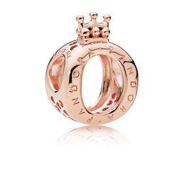 Charm O Couronné PANDORA Pandora Rose est un bijou en métal doré à ...
