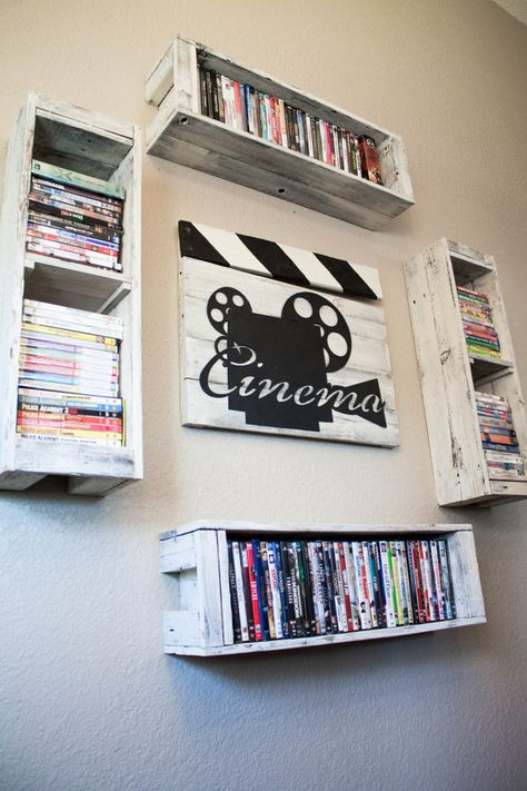 Cinema Clapperboard decor from reclaimed wood with four DVD storage shelves on Etsy, $150.00