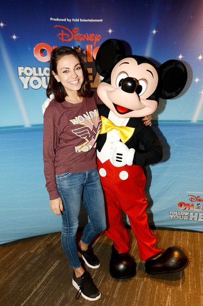 Actress Mila Kunis (L) and Mickey Mouse attend 'Disney on Ice: Follow Your Heart' at Staples Center.